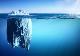 77391653 - iceberg floating on sea - appearance and global warming concept